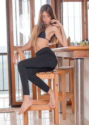 Slender beauty Mily Mendoza pulls off her yoga pants to squat on a big dildo