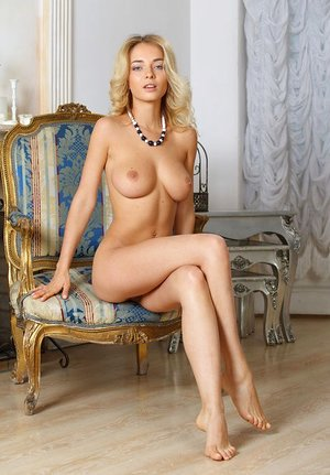 Naked blonde Annabell fondles perfect inborn gigantic tits showing puffies closeup