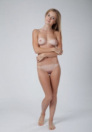 Thin blonde dame Flower poses her sunburn lined body in the nude