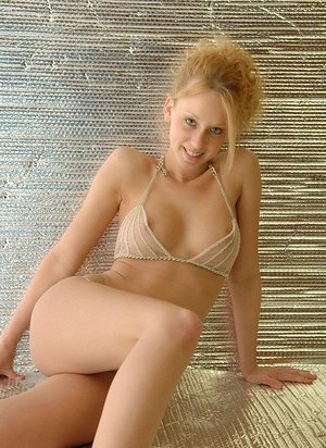 Happy torrid blonde inexperienced Lucky removes bra to pose with perfect tits bare