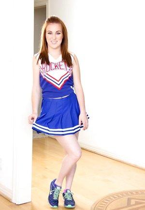 Cute redhead cheerleader Jessie Parker cheerfully spreading her tight ass
